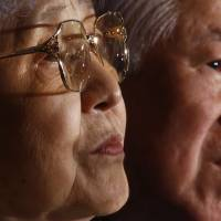 Shigeru Yokota and his wife, Sakie, the parents of Megumi Yokota, who was abducted by North Korea in 1977, listen to a reporter's question during a news conference at the Foreign Correspondents' Club of Japan in Tokyo on Monday. | AP