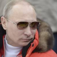 Russian President Vladimir Putin watches a skiing event at the Paralympic Winter Games at Rosa Khutor, near Sochi, Russia, on Sunday. | REUTERS