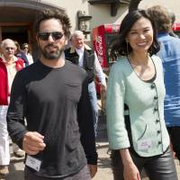 Sergey Brin, co-founder of Google Inc. and Wendi Deng Murdoch leave the morning session of the Allen & Co. Media and Technology Conference in Sun Valley, Idaho, in July 2012. Brin and co-founder Larry Page were paid their their customary $1 salaries by the company last year while Executive Chairman Eric Schmidt's compensation more than doubled to $19.3 million. | BLOOMBERG