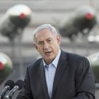 Israeli Prime Minister Benjamin Netanyahu speaks to the press at the southern port of Eilat on Monday, as Israel displayed advanced type M-302 rockets that were unloaded from a Panamanian-flagged Klos-C vessel on Sunday. The missiles were allegedly being transported from Iran to Gaza when they were seized by Israeli naval commandos on March 5. | AFP-JIJI