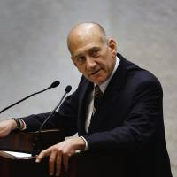 Israeli Prime Minister Ehud Olmert addresses parliament before a swearing-in ceremony for Benjamin Netanyahu's new government in Jerusalem on March 31, 2009. | REUTERS