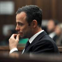 South African Paralympic athlete Oscar Pistorius cries during his trial in Pretoria on Wednesday. | AFP-JIJI