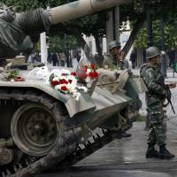 Flowers are displayed on a tank as soldiers guard the center of Tunis on Jan. 18, 2011.   AP