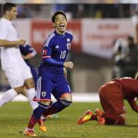 Still got it: Shinji Kagawa reacts after scoring against New Zealand during Japan's 4-2 win on Wednesday at National Stadium. | AP