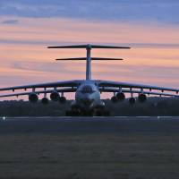Two Chinese Ilyushin IL-76s aircraft sit on the tarmac at RAAF Pearce base in Perth, Australia, on Saturday, ready to join the search for missing Malaysia Airlines Flight MH370. In eastern Australia, a light aircraft used for skydiving crashed and burst into flames Saturday, killing all five people on board. | AP