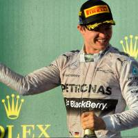New era: Mercedes driver Nico Rosberg celebrates his win at the Australian Grand Prix in Melbourne on Sunday. | AFP-JIJI