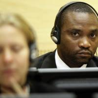 Former Congolese warlord militiaman Germain Katanga sits in the courtroom of the International Criminal Court in The Hague in 2009. The International Criminal Court found him guilty Friday for his role in acts of murderous carnage. | AFP-JIJI