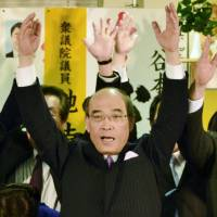 Ishikawa Gov. Masanori Tanimoto, who appeared assured of a sixth four-year term in Sunday's gubernatorial election, leads supporters in a lusty cry of 'Banzai!' in Kanazawa. | KYODO