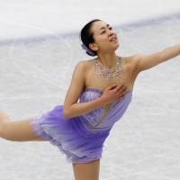 Reach out: Mao Asada performs her short program at the world championships at Saitama Super Arena on Thursday. Mao scored a world-record 78.66 points. | REUTERS