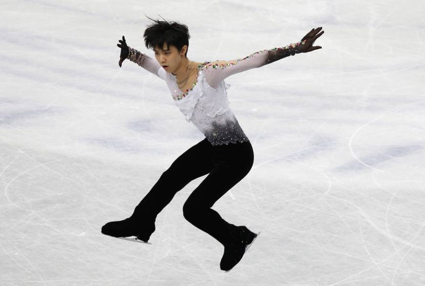Hanyu delivers splendid free skate, overtakes Machida for world title