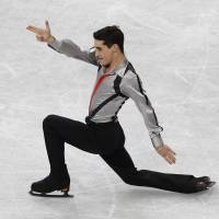 Here to contend: Spain's Javier Fernandez earns the bronze medal in the men's competition at the World Figure Skating Championships on Friday. | REUTERS