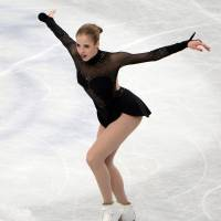 Respectable showing: Italy's Carolina Kostner places third in the women's competition at the world championships.   AFP-JIJI