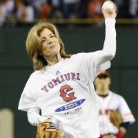Time to play: U.S. Ambassador to Japan Caroline Kennedy tosses the ceremonial first pitch at Tokyo Dome on Friday night. | KYODO