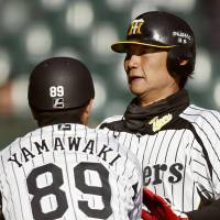 Early setback: The Tigers' Ryota Arai (right) and his Hanshin teammates dropped a 6-2 home decision against the Chiba Lotte Marines on Friday in a preseason game. | KYODO
