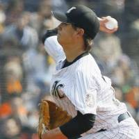 Tough start: Chiba Lotte hurler Hideaki Wakui allows eight runs in five innings against Yomiuri in his first spring training start this season on Wednesday. The Giants defeated the Marines 12-5. | KYODO