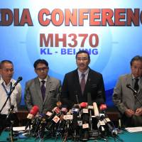 Malaysia's acting transport minister, Hishammuddin Hussein (second from right) speaks as Foreign Minister Anifah Aman (right) Department of Civil Aviation Director General Azharuddin Abdul Rahman (second from left) and Malaysia Airlines Group Chief Executive Ahmad Jauhari Yahyain listen during a news conference in Sepang on Tuesday. | AP