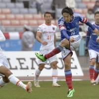 Twice as nice: Yokohama F. Marinos forward Sho Ito scores his side's second goal of the game in Sunday's 2-0 win over Omiya Ardija. | KYODO