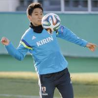United we stand: Shinji Kagawa controls the ball in a training session on Monday ahead of Japan's friendly against New Zealand at National Stadium on Wednesday. | KYODO