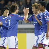 Team support: Jin Hanato (second from right) is congratulated by Yokohama F. Marinos teammates after scoring in the first half against Guangzhou Evergrande in an Asian Champions League match on Wednesday in Yokohama. | KYODO