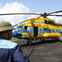 A Russian-made MI-171 helicopter is prepared to start a new search for missing Malaysia Airlines Flight MH370 in Ca Mau, Vietnam, on Monday. | AFP-JIJI