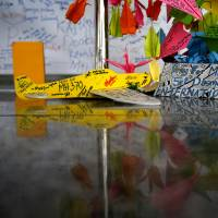 A toy plane and cards with personalized messages dedicated to people on missing Malaysia Airlines Flight MH370 are placed at the viewing gallery of Kuala Lumpur International Airport on Saturday.   AP