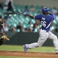 Puig leads Dodgers to win in Australia