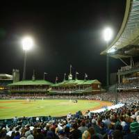 Whole new ball game: Fans watch the opening game of the MLB season between the Los Angeles Dodgers and the Arizona Diamondbacks at the Sydney Cricket Ground on Saturday night. | KYODO/GETTY