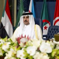 Qatar's Sheik Tamim bin Hamad bin Khalifa Al Thani attends the 25th Arab League summit at Bayan palace in Kuwait City on Tuesday. | AFP-JIJI