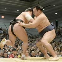 Crowning achievement: Kakuryu (right) won the Spring Grand Sumo Tournament on Sunday in Osaka with a 14-1 record. | KYODO