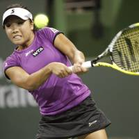 Another day at the office: Kurumi Nara hits a return to Allie Kiick in the first round of the BNP Paribas Open on Wednesday in Indian Wells, California. Nara advanced with a 6-4, 6-0 triumph. | KYODO