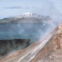 Hot stuff: A man stands next to volcanic steam in Antarctica. | AFP-JIJI