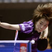 London Olympic silver medalists Kasumi Ishikawa takes aim on the first day of the world team table championship in Tokyo Monday.    KYODO