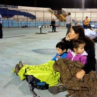 Locals take refuge at the city stadium following a tsunami alert after a powerful 8.2-magnitude earthquake hit off Chile's Pacific coast Tuesday evening.