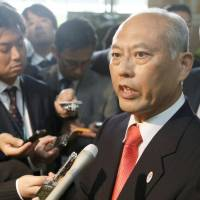 Tokyo Gov. Yoichi Masuzoe speaks to the press in Tokyo after his recent trip to Beijing.  | KYODO