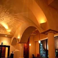 With its high vaulted arches, the interior is so simple and serene it almost feels austere.    ROBBIE SWINNERTON