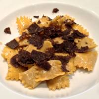Agnolotti del plin, a Piedmontese version of ravioli stuffed with three kinds of meat (beef, pork and rabbit) and topped with truffles.   ROBBIE SWINNERTON