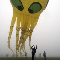 An octopus-shaped kite plies the smog in Chongqing, China, on April 6. | REUTERS