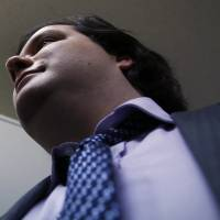 Mt. Gox CEO Mark Karpeles leaves the Tokyo District Court after the firm filed for bankruptcy Feb. 28. | REUTERS