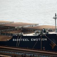 The Baosteel Emotion, a 226,434-ton ore carrier operated by Mitsui O.S.K. Lines, is seen docked at the port of Maji Island, south of Shanghai, on Tuesday. A Chinese maritime court in Shanghai seized the ship Saturday in a move Tokyo warned could have an adverse impact on Japanese businesses in China. | REUTERS