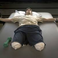 Jeff Bauman, who lost his lower legs in the Boston Marathon bombings, is seen in a picture taken by New York Times photographer Josh Haner. The photo was part of Haner's Pulitzer Prize-winning entry for feature photography announced by Columbia University in New York on Monday.   REUTERS
