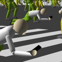 A computer simulation by NTT Docomo Inc. shows pedestrians with smartphones stumbling as they cross the famed intersection in front of Shibuya Station in Tokyo.   NTT DOCOMO INC/YOUTUBE