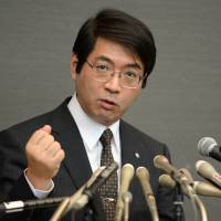 Yoshiki Sasai, who supervised Riken institute subordinate Haruko Obokata in the drafting of two controversial papers on STAP cells, fields questions during a news conference in Tokyo on Wednesday in his first public comments since the allegedly pioneering stem-cell technique was widely discredited. | AFP-JIJI