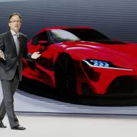 Bill Fay, Toyota group vice president, delivers a sales pitch during the 2014 New York auto show on April 16. | BLOOMBERG