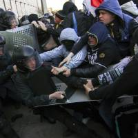 Pro-Russian protesters scuffle with police near the regional government building in the eastern Ukraine city of Donetsk Sunday. | REUTERS