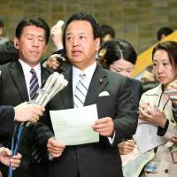 Akira Amari, minister in charge of the Trans-Pacific Partnership negotiations, speaks to reporters Friday morning after the U.S. and Japan failed to reach an agreement on trade. | KYODO