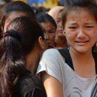 Relatives of Mount Everest avalanche victims grieve as bodies arrive at the Sherpa monastery in Katmandu on Saturday. | AFP-JIJI
