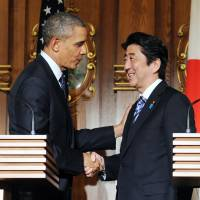 U.S. President Barack Obama and Prime Minister Shinzo Abe wrap up their joint news conference Thursday at the Akasaka State Guest House in Tokyo. | KYODO