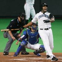Back in the day: Fernando Seguignol, who is now a scout for the Yomiuri Giants, played parts of eight seasons in Japan and hit 172 home runs here.   KYODO