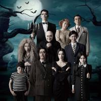 Necro but nice: Morticia (Tsubasa Makoto), with husband Gomez (Satoshi Hashimoto) on her right, fronts this spooky snap of 'The Addams Family' musical's Tokyo cast.