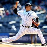 Blazing: New York's Masahiro Tanaka fires a pitch against the Chicago Cubs in the first inning on Wednesday.   KYODO